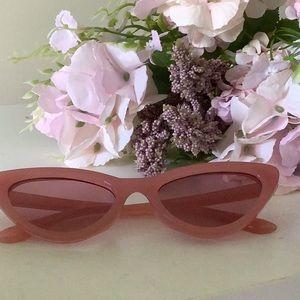 Triangular oval shaped frame sunglasses.